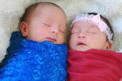 Cute twins sleeping. Together, these are a boy and a girl stock image