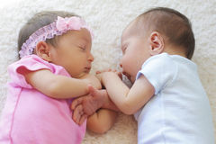 Cute twins sleeping. Together, these are a boy and a girl stock images