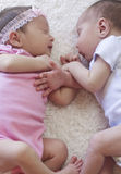Cute twins sleeping stock images