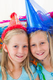 Cute twins during their birthday party Stock Photo