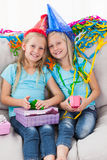Cute twins unwrapping their birthday present Royalty Free Stock Photo
