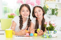 Cute Twins Wearing Rabbit Ears Decorating Easter Eggs Royalty Free Stock Photography