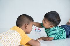 Cute two brother lying on the floor stock photo