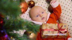 Cute two-month baby girl celebrates her first Christmas stock video footage