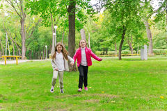Cute two running girls Royalty Free Stock Photography