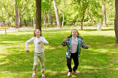 Cute two running girls Royalty Free Stock Image