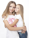 Cute two sisters, embrace isolated on a white background Stock Photo