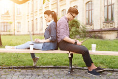 Cute two students are making a break Stock Image
