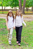 Cute two walking girls Royalty Free Stock Photo