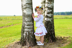 Cute Ukrainian girl playing in the nature Stock Images