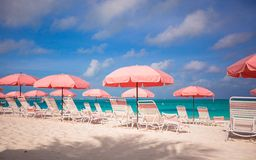 Cute umbrellas and sunbeds at tropical beach Stock Images