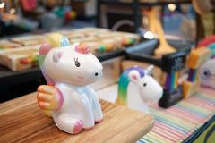 Cute unicorn doll on display. A pegasus with rainbow mane is sit royalty free stock photos