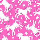 Cute unicorn seamless pattern with stars Stock Photos
