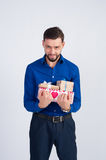 Cute unshaven man gives gifts Royalty Free Stock Photography