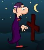 Cute vampire looks at a cross. Royalty Free Stock Photos
