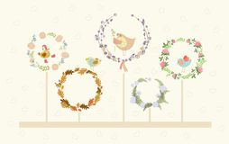 Cute vector floral wreaths and birds. Set of cute floral wreaths and birds in them Royalty Free Stock Photo