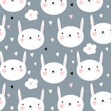 Cute vector seamless background with rabbits and hearts. Royalty Free Stock Photo