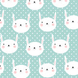 Cute vector seamless background with rabbits and polka dots. Royalty Free Stock Image