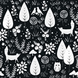 Cute vector seamless pattern with forest plants, birds, and foxes silhouettes. White and black background Royalty Free Stock Photos