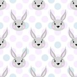 Cute vector seamless pattern with rabbit face, hare. On white background in polka dots. vector illustration