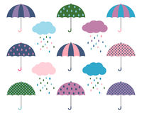 Cute vector umbrellas with rain clouds - flat design Royalty Free Stock Images