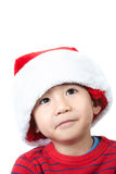 Cute Vietnamese boy wearing Christmas hat. On white background Royalty Free Stock Photos