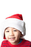 Cute Vietnamese boy wearing Christmas hat. On white background Royalty Free Stock Images