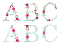 Cute vintage alphabet letters with hand drawn rustic flowers. Isolated on white background Royalty Free Stock Images