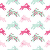 Cute vintage Easter seamless pattern with bunnies as retro fabric patch applique in shabby chic style. Can be used for kitchen textile, table cloth design, bed Royalty Free Stock Photo
