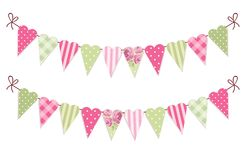 Cute vintage heart shaped shabby chic textile bunting flags. Ideal for Valentines Day, wedding, birthday, bridal shower, baby shower, retro party decoration etc Royalty Free Stock Image