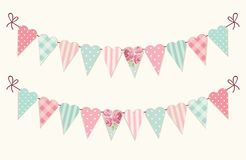 Cute vintage heart shaped shabby chic textile bunting flags. Ideal for Valentines Day, wedding, birthday, bridal shower, baby shower, retro party decoration etc Royalty Free Stock Images