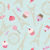Cute vintage seamless pattern background with Eiffel tower and cupcakes. Stock Image