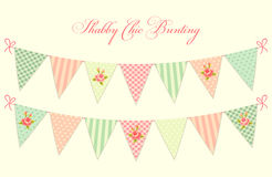 Cute vintage shabby chic textile bunting flags ideal for baby shower, wedding, birthday. Bridal shower, retro party decoration etc Stock Photos