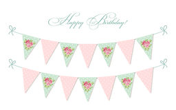Cute vintage shabby chic textile bunting flags ideal for baby shower, wedding, birthday. Bridal shower, retro party decoration etc Royalty Free Stock Photo