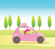 Cute vintage style girl driving a pink car Royalty Free Stock Photo