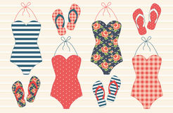 Cute vintage swimsuits and flip-flops Stock Images
