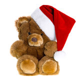 Cute vintage teddy bear with red santa hat Royalty Free Stock Image