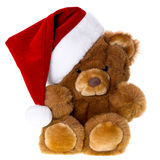 Cute vintage teddy bear with santa hat Royalty Free Stock Photography