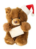 Cute vintage teddy bear with santa hat and greetings card Royalty Free Stock Photography