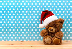 Cute vintage teddy bear with santa hat Stock Images