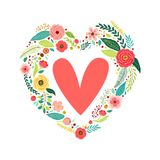 Cute vintage Valentine`s Day symbol as rustic hand drawn first spring flowers in heart shape Royalty Free Stock Photography