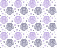 Cute violet and grey owls with stars in the background Stock Photos