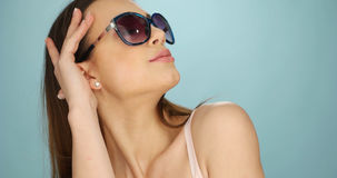 Cute vivacious woman in sunglasses Royalty Free Stock Image