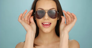 Cute vivacious woman in sunglasses Royalty Free Stock Photography