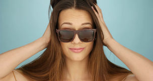 Cute vivacious woman in sunglasses Royalty Free Stock Photo