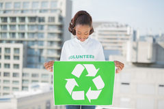 Cute volunteer woman holding recycling sign Royalty Free Stock Photography