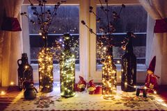 Cute and warm Christmas decoration set with vintage beer bottles and wine bottles filled with micro led party lights.