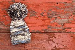 Cute warm woolen winter hat with a large pompom Stock Image