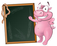 Cute Waving Pig Character with Chalk Board. Stock Photo