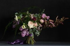 Wedding bouquet with lilac. Cute wedding bouquet with lilac and other spring flowers made by florist Stock Images